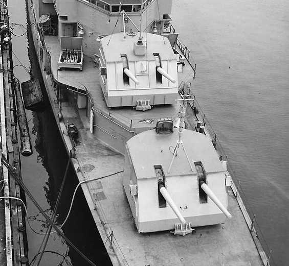 Black and white historic photo of WWII Naval Cannons